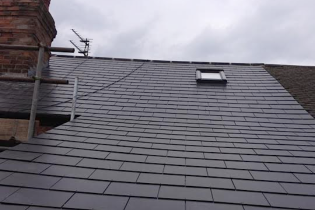 Composite Slate and Velux window on small terrace roof